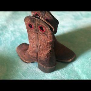 Little boys Ariat cowboy boots.